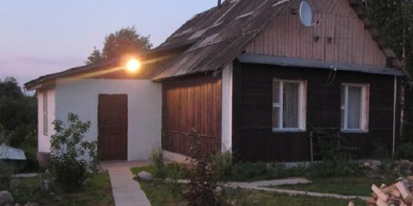 Деревянный дом  для  отдыха гостей усадьбы